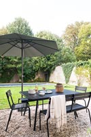 Outdoor dining area, lawn and swimming pool