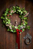 Close up of Christmas wreath on wooden front door