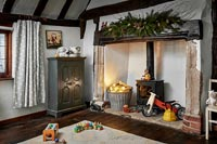 Large fireplace in childrens room decorated for Christmas
