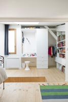 Dressing table and wardrobes in modern bedroom