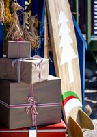 Close up of Christmas decorations and decorated surf board