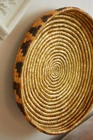 Circular basket on wall as decoration
