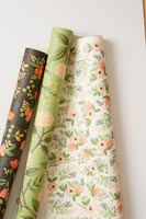 Rolls of various floral wallpaper