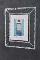 Chalk picture frame drawn on blackboard to surround picture