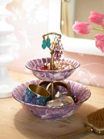 Decorative bowl of jewelry on dressing table