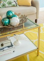 Decorative baubles on coffee table in colourful living room
