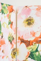Detail of colourful floral wallpaper used to cover screen