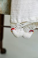 Detail of crocheted chickens on tea towel