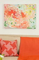Colourful painting and cushions in modern living room