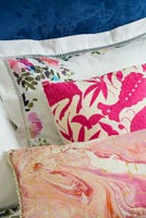 Variety of pillows and cushions with different patterns