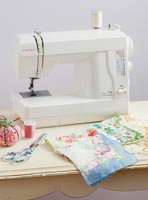 Sewing machines with vintage handkerchiefs and sewing accessories