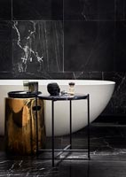 Marble tiling in modern black and white bathroom