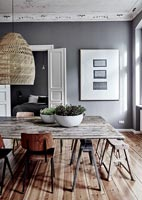 Rustic wooden table and vintage chairs in modern dining room