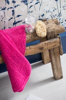 Rustic wooden stool with bathroom accessories