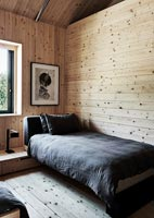 Contemporary twin bedroom in wooden cabin