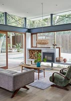 Modern glazed living room with wood burning stove