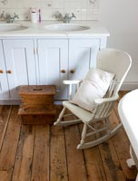 Rocking chair and step for child in country bathroom