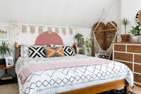 Eclectic bedroom with macrame swing seat