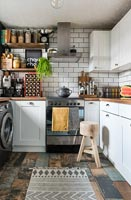Modern kitchen with distressed paint on wooden floorboards