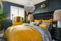 Eclectic black and yellow bedroom