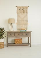 Sideboard and macramé wall hanging
