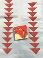 Red triangle stamp used to decorate fabric