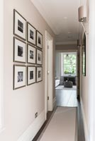 Modern corridor with display of framed photographs on wall