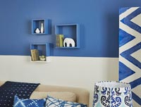 Modern living room with blue painted wall and accessories