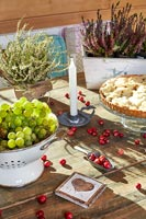 Fruit, berries and potted heather on country dining room table