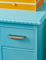 Turquoise chest of drawers with metal pull handle