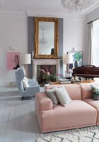 Pink modular sofa in living room with piano