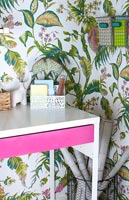 Modern home office with colourful wallpaper and accessories