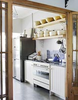 Classic kitchen through doors