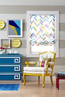 Colourful living room with geometric patterned accessories