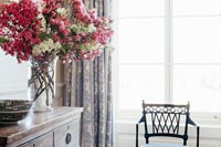 Flower arrangement and classic chair