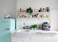 Turquoise fridge freezer in white kitchen
