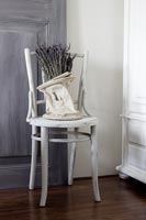 White distressed chair with lavender