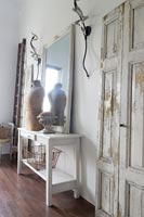White console table with mannequin