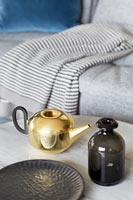 Golden teapot on coffee table