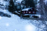 Chalet in the snow at night