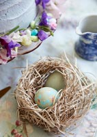 Floral ornamental eggs in nest