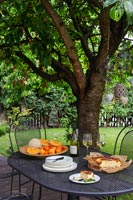 Fruits and cake on garden table