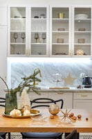 Modern kitchen-diner with Christmas decorations
