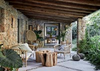 Porch of stone country house with outdoor living area
