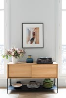 Wooden sideboard storing plates