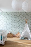 Play tippee in childrens bedroom with floral wallpaper