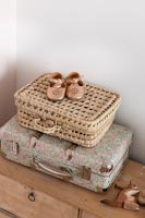 Detail of baby shoes on tiny suitcase