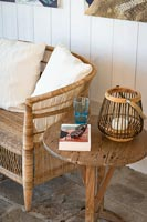 Book and sunglasses on wooden side table