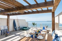 Outdoor dining area overlooking the sea
