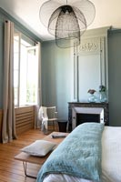 Aqua blue painted modern bedroom with period features